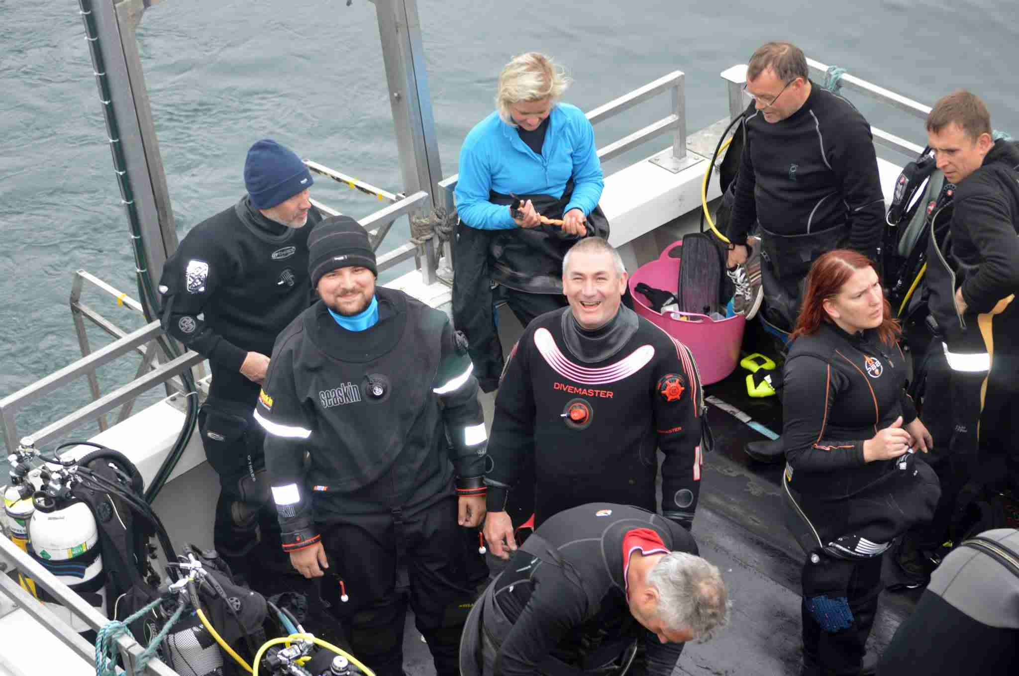 Divers waving on dive boat at Farne Islands